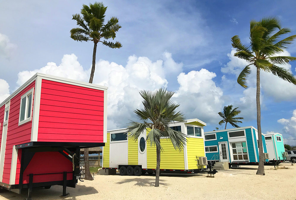 The five new tiny houses that make up Petite Retreats Sunshine Key Tiny House Village, aptly named Kai, Pearl, Lucy, Isla, and Hemingway, are each under 350 square feet in size. The colorful tiny house village resides on the shore of the 75-acre island of Sunshine Key RV Resort and Marina near Big Pine Key.