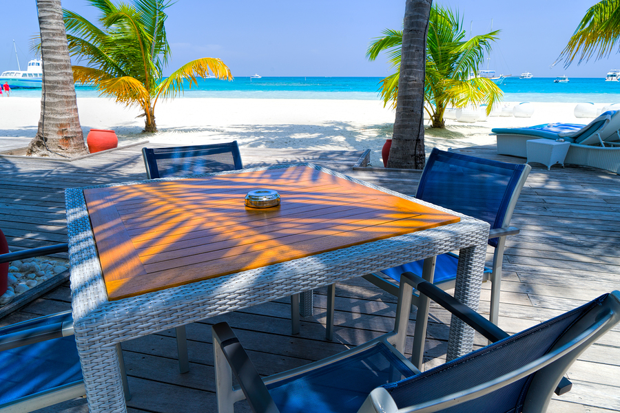 Outdoors beach restaurant. Tropical resort coast, relaxing summer shore. Luxury resort restaurant, chairs and tables in elegant set up