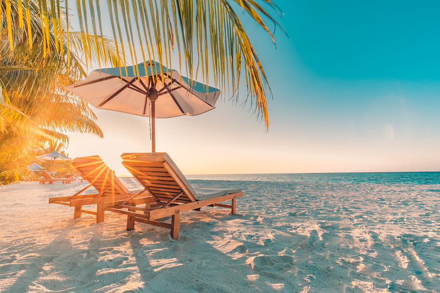 Perfect sunset beach. Idyllic tropical beach landscape for background or wallpaper. Design of summer vacation holiday concept. Luxury resort hotel background, romantic couple or honeymoon getaway, travel destination